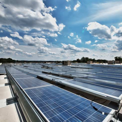 A rooftop installation of 1,034 Solar Panels that can absorb enough energy from the sun to produce 295 kilowatts per hour.