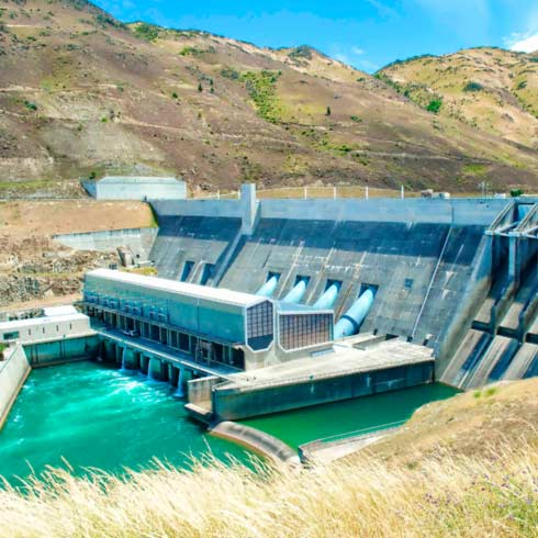 Hydro electric dam with grassland and hills, water management, energy efficiency.